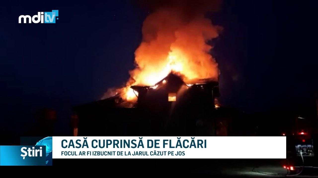 CASĂ CUPRINSĂ DE FLĂCĂRI