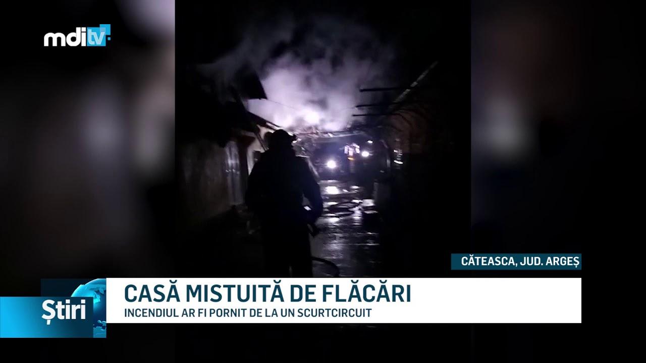 CASĂ MISTUITĂ DE FLĂCĂRI